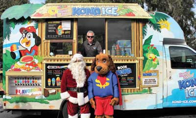 Dollar Dog and Santa in front of snowcone truck